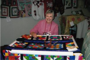 July Brumfield demonstrates hand quilting at 2009 Quilt Show